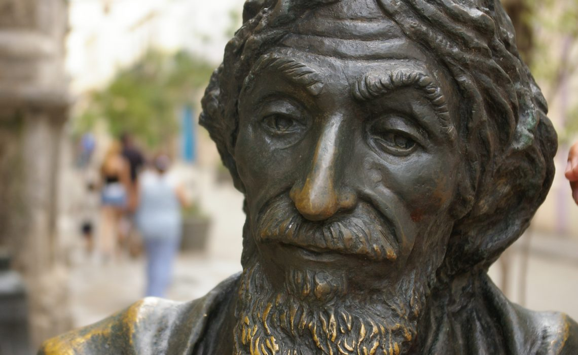 A photograph of a statue called 'The Old Man of Paris' in Havana, Cuba.